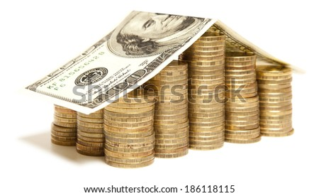 Money house with golden coin isolated over white background - stock photo