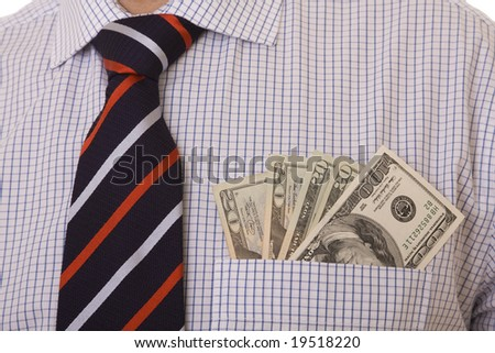 money in a businessman pocket (selective focus)