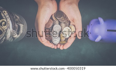 Money in a child hand, saving - stock photo