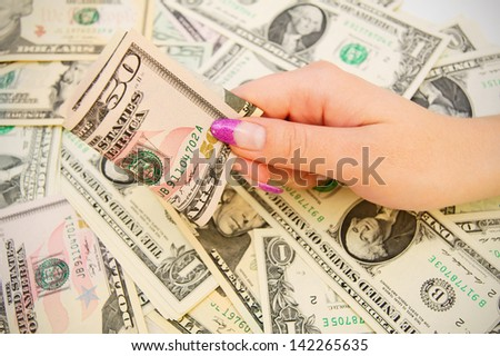 Money in a female hand.
