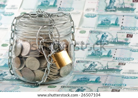Money in a pot. Home banking concept. - stock photo