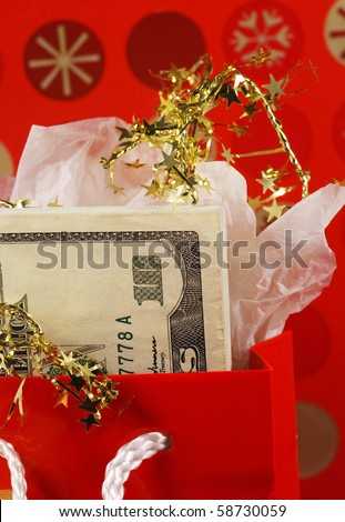 Money in a red gift bag concepts of gift of money - stock photo