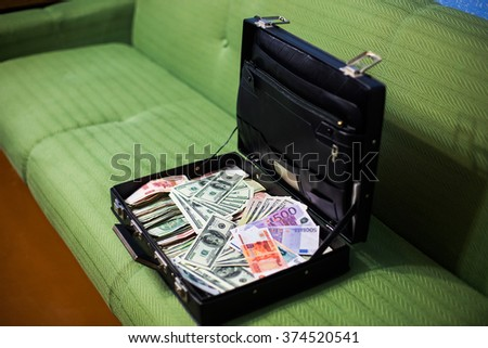 money in a suitcase, a lot of money, hundred dollar bills, euros, rubles, bride preparing for the wedding, money bag, millionaire businessman gangster - stock photo