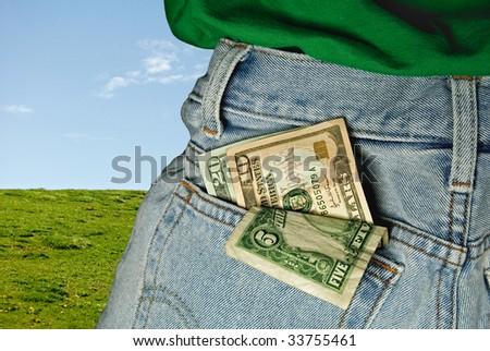 money in blue jean pocket - stock photo