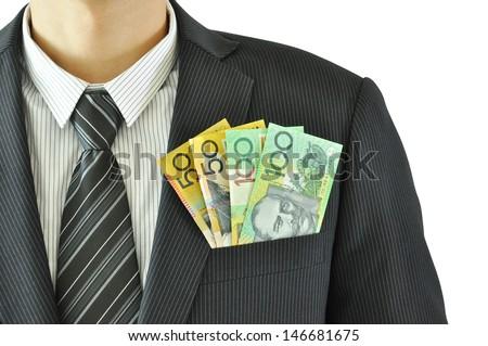 Money in businessman pocket suit - Australian Dollar banknotes - stock photo