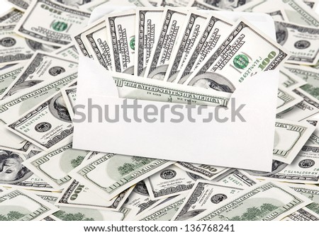 money in envelope isolated on white