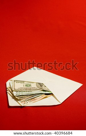 Money in envelope on red backgrounds - stock photo