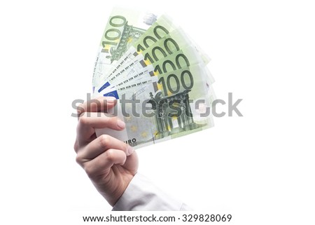 Money in euro currency hold in hand isolated on white background