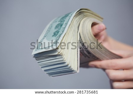 Money in female hands - stock photo