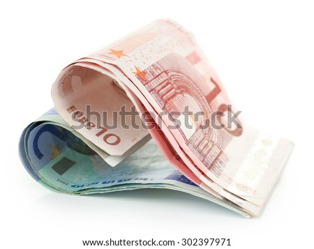 Money in form of heart isolated on white - stock photo