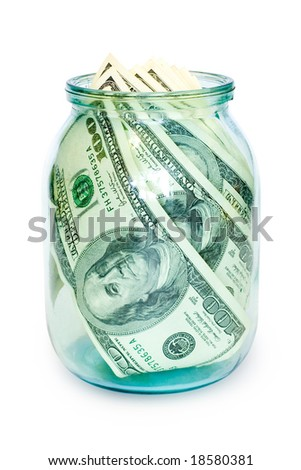 money in glass jar isolated on white