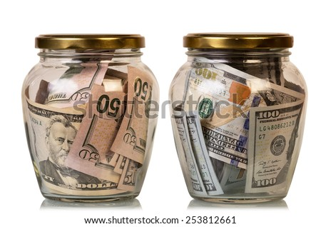 Money in glass jars, isolated on white background - stock photo