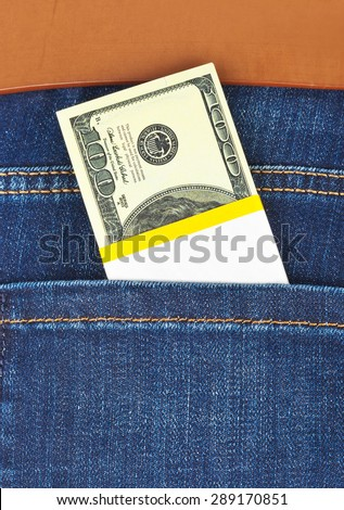 Money in jeans pocket - shopping background - stock photo