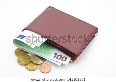Money in leather wallet on white background   - stock photo