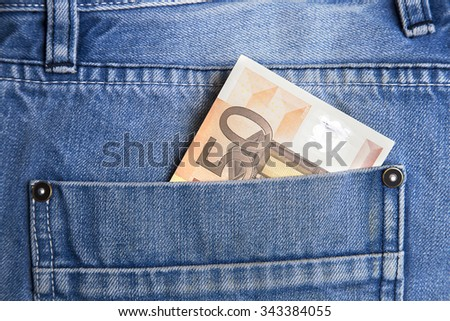 money in pocket, fifty euro  in pocket. - stock photo