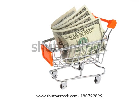 Money in shopping cart isolated on white a background - stock photo