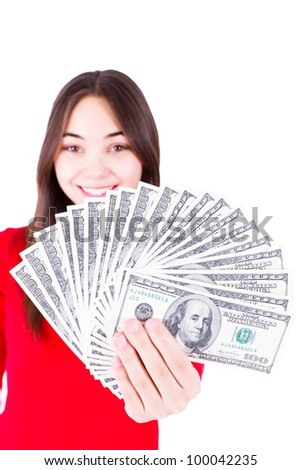 Money In Teenager Hands,  Teenager holding and showing all one hundred dollar banknotes in her red shirt with a sweet smile. Isolated on white background. - stock photo