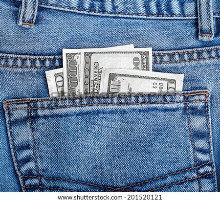 Money in the back pocket of jeans - stock photo