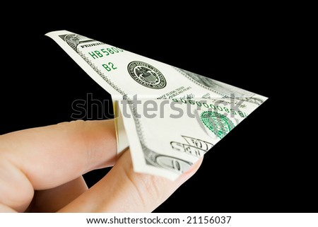 money in the fingers isolated on black - stock photo