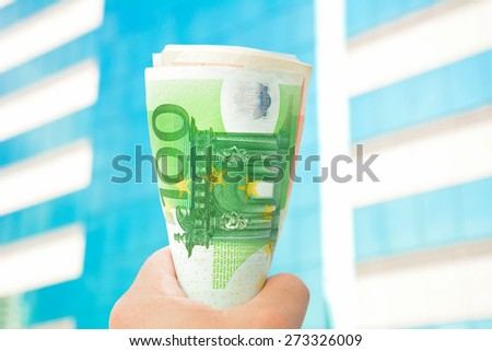 Money in the fist - Euro  currency (EUR) - stock photo