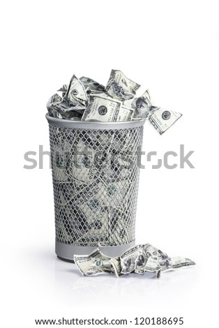 Money in the garbage can with clipping path - stock photo