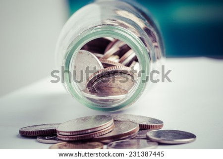 money in the glass bottle isolate on white background, process color - stock photo