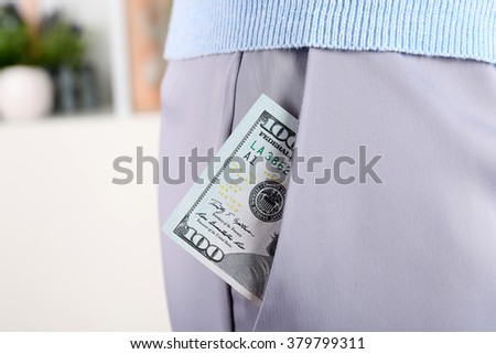 Money in the grey pocket, close up