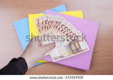 money in the hand - stock photo