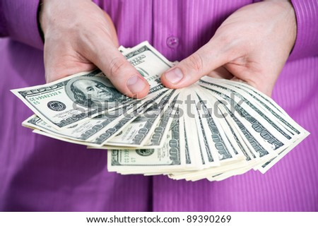 Money in the hand of businessman - stock photo