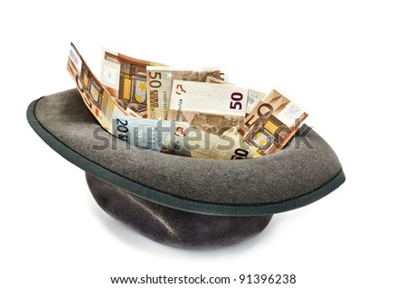 money in the hat: a loan or deposit - stock photo