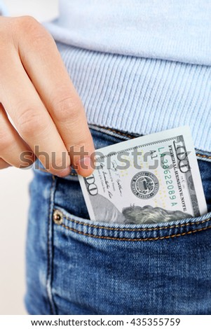 Money in the jeans pocket, close up - stock photo