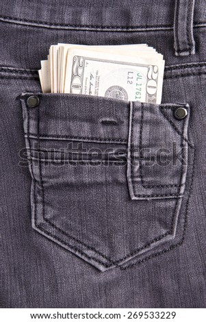 Money in the jeans pocket. Dollars. Twenty-dollar bills - stock photo
