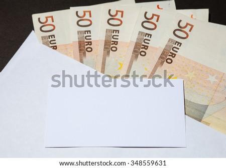 Money in the white envelope, closeup shot - stock photo