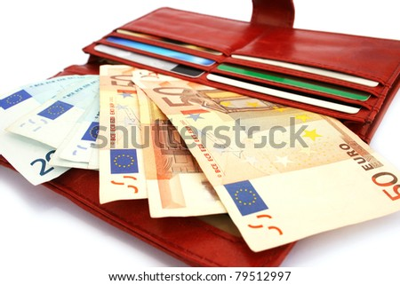Money in wallet isolated on white background.