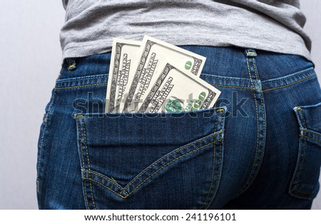 money in your pocket - stock photo