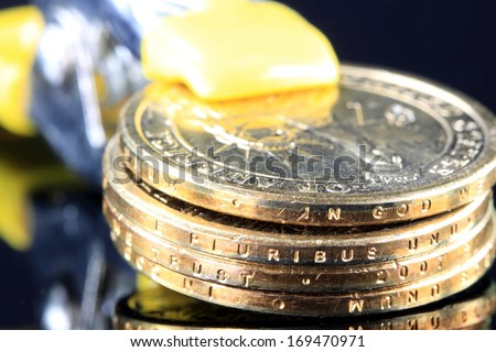 Money is Tight - Financial Concept US Currency gold coins in a tool clamp - stock photo
