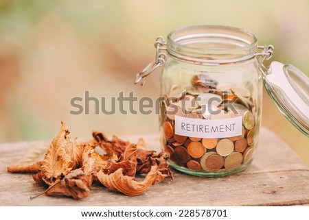 Money jar full of coins as a retirement fund.