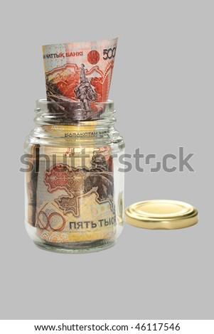 Money Kazakhstan in a glass jar. - stock photo