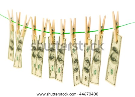 Money laundering concept with dollars on the rope