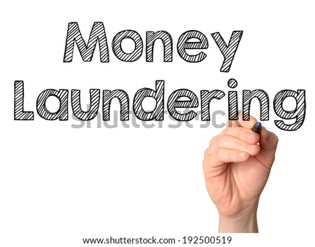 Money Laundering handwritten on white background - stock photo