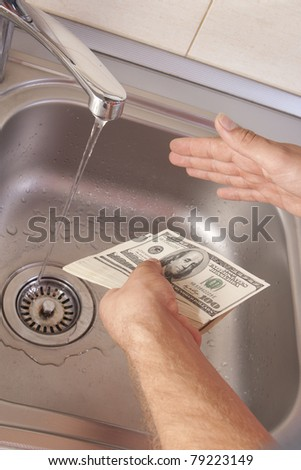 money laundering in washbasin - stock photo