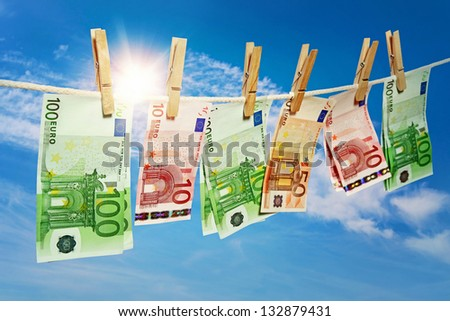 Money laundering on clothesline - stock photo
