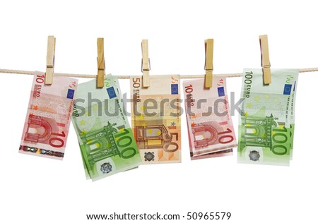 Money laundering on clothesline isolated on white background