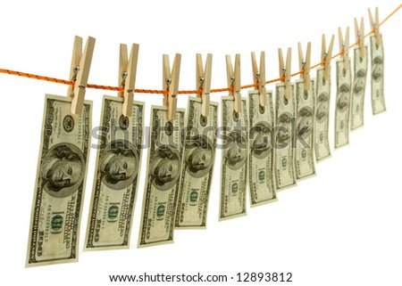 Money laundering on string with clothespins isolated on white background - stock photo