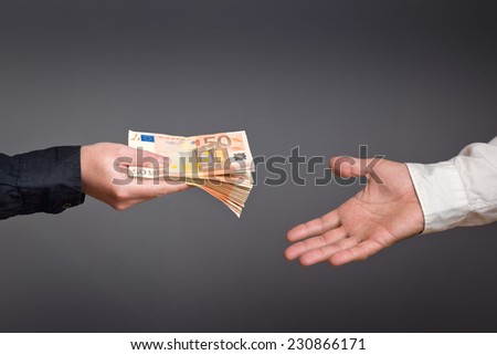 Money Loan. Bank officer loaning stack of euro banknotes money. - stock photo