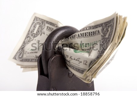 money locked up in a big padlock - stock photo