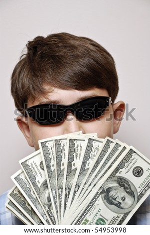 Money Man.Boy holding a fan of one hundred dollar bills - stock photo