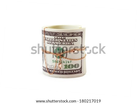 money of roll entwisted by gold on a white background isolated