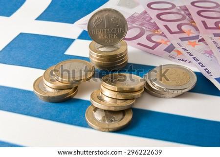 Money on a Greek flag - stock photo