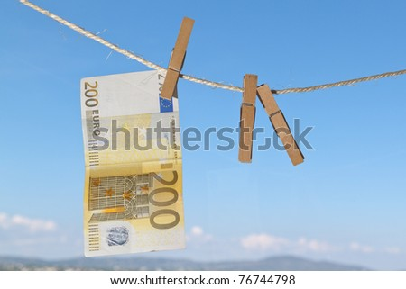 money on a linen cord - stock photo
